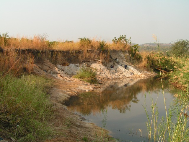 Various experts at work on the banks of the Kalambo River