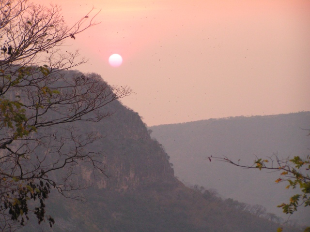 Watching the sun sink down to Lake Tanganyika through the gorge over the gorge below the waterfall, from campsite