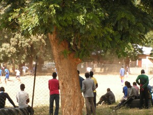 Men in Zambia watch football