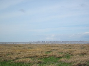 The Ribble estuary and Blackpool in the distance on the marsh flats by the sea