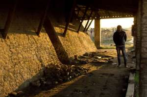 Refugee in abandoned brick factory in Serbia waits for his smuggler to get him to Europe. UNHCR picture