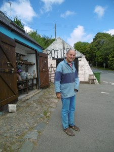 Oldrich asenbryl outside his shop in Sarn