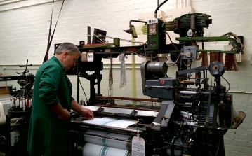 Graeme tending a Jacquard loom (runs on punch cards, complex patterns possible) made in Blackburn